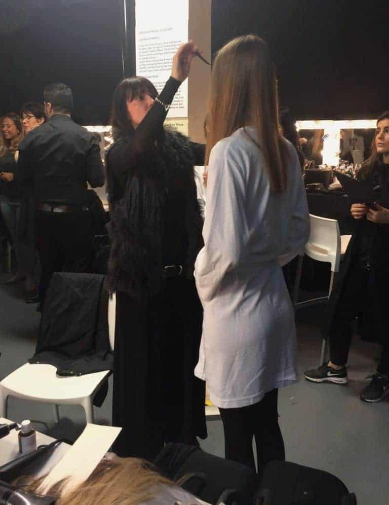 Hair stylist Sam Hillerby backstage at London Fashion Week, FashionBite
